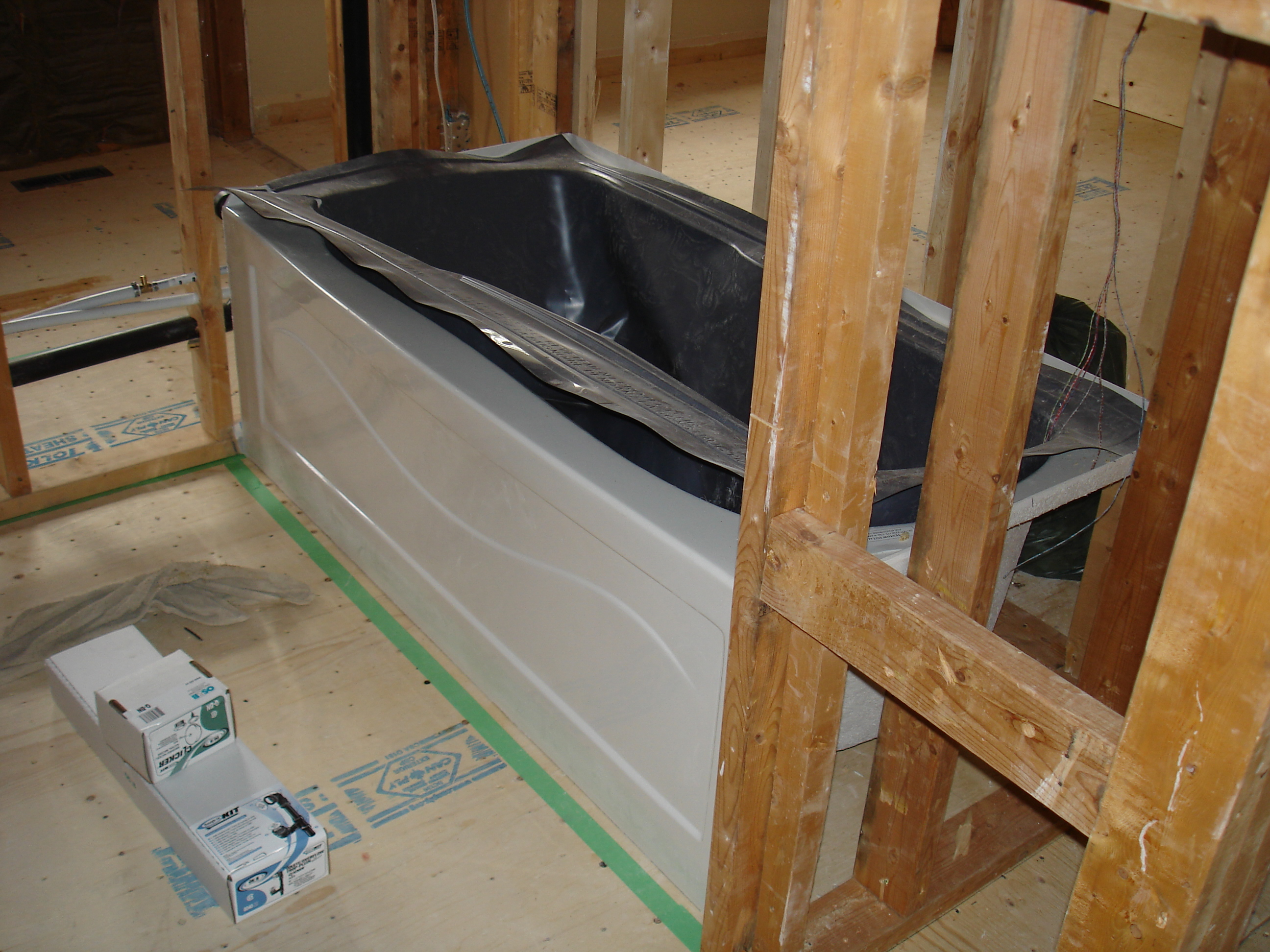 how to finish a roughed in bathroom in basement